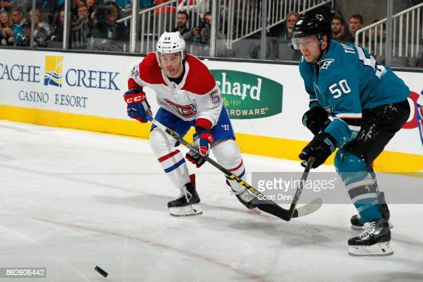 Charles Hudon of the Montreal Canadiens and Chris Tierney of the San Jose Sharks watch the puck at SAP Center on October 17 2017 in San Jose...