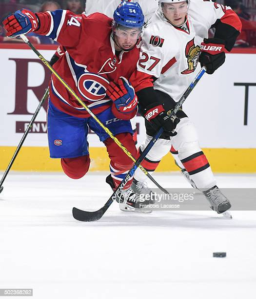 Charles Hudon of the Montreal Canadiens and Curtis Lazar of Ottawa Senators battle for the puck in the NHL game at the Bell Centre on December 12...