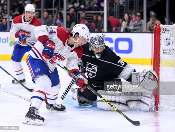 Charles Hudon of the Montreal Canadiens attempts a shot on Jonathan Quick of the Los Angeles Kings at Staples Center on October 18 2017 in Los...
