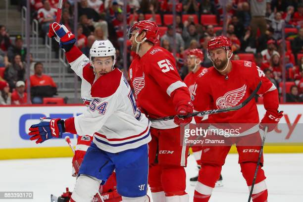 Charles Hudon of the Montreal Canadiens celebrates a third period goal by teammate Brendan Gallagher net to Niklas Kronwall of the Detroit Red Wings...
