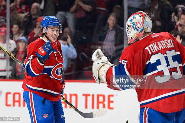 Charles Hudon of the Montreal Canadiens congratulates goaltender Dustin Tokarski for their victory during the NHL game against the Ottawa Senators at...