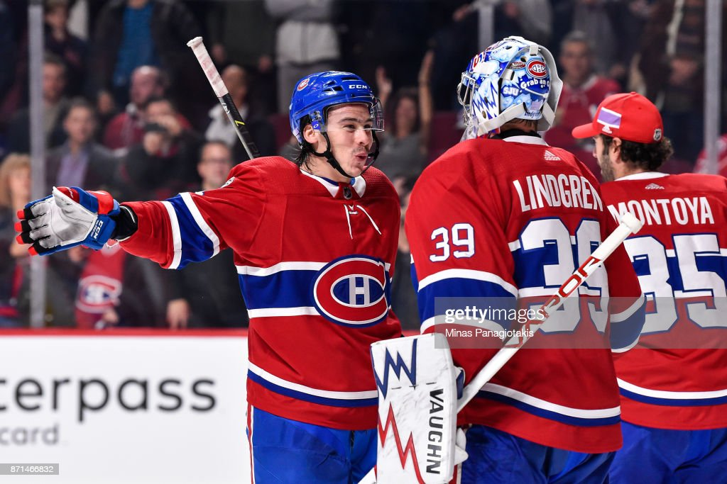Charles Hudon #54 of the Montreal Canadiens congratulates teammate Charlie Lindgren #39 for their victory against the Vegas Golden Knights during the NHL game at the Bell Centre on November 7, 2017 in Montreal, Quebec, Canada. The Montreal Canadiens defeated the Vegas Golden Knights 3-2.