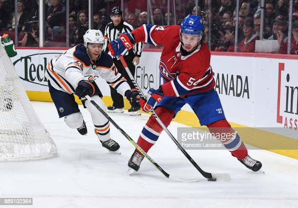 Charles Hudon of the Montreal Canadiens controls the puck while being challenged by Darnell Nurse of the Edmonton Oilers in the NHL game at the Bell...