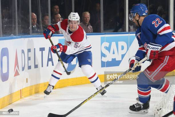 Charles Hudon of the Montreal Canadiens passes the puck against Kevin Shattenkirk of the New York Rangers at Madison Square Garden on October 8 2017...