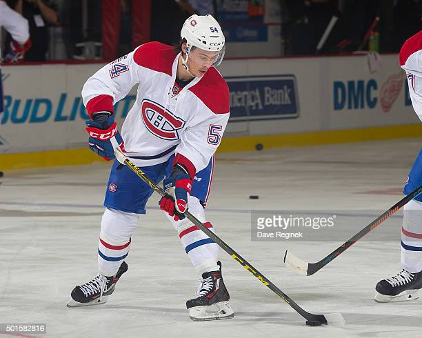 Charles Hudon of the Montreal Canadiens shoots the puck in warmups prior to his first NHL game against the Detroit Red Wings at Joe Louis Arena on...