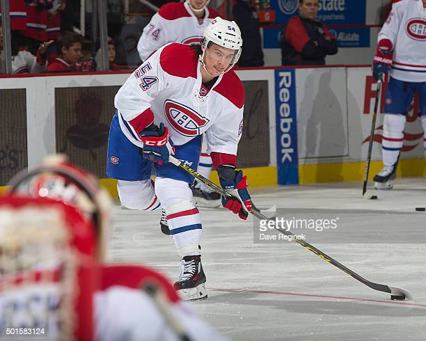 Charles Hudon of the Montreal Canadiens shoots the puck in warmups prior to an NHL game against the Detroit Red Wings at Joe Louis Arena on December...