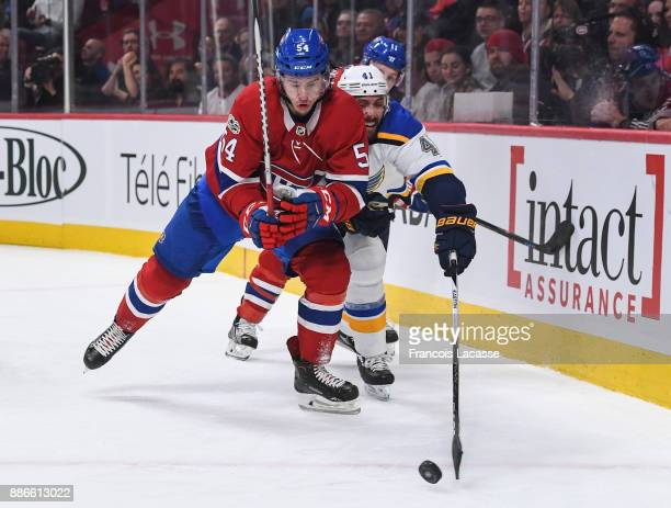 Charles Hudon of the Montreal Canadiens skates for the puck against Robert Bortuzzo of the St Louis Blues in the NHL game at the Bell Centre on...