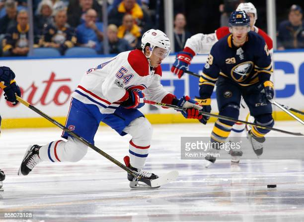 Charles Hudon of the Montreal Canadiens skates up ice with the puck during the third period against the Buffalo Sabres at the KeyBank Center on...