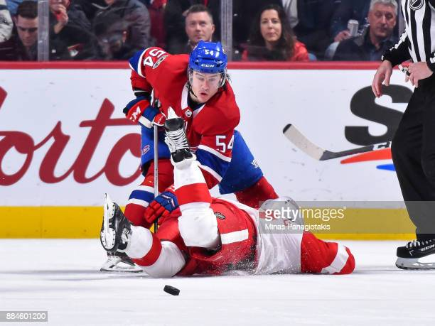 Charles Hudon of the Montreal Canadiens takes down Henrik Zetterberg of the Detroit Red Wings during the NHL game at the Bell Centre on December 2...
