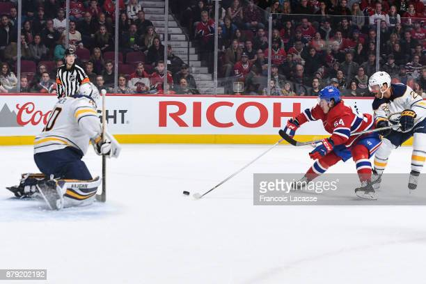 Charles Hudon of the Montreal Canadiens tries to score against Robin Lehner of the Buffalo Sabres in the NHL game at the Bell Centre on November 25...