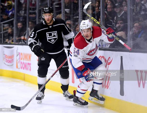 Charles Hudon of the Montreal Canadiens turns for the puck in front of Christian Folin of the Los Angeles Kings at Staples Center on October 18 2017...