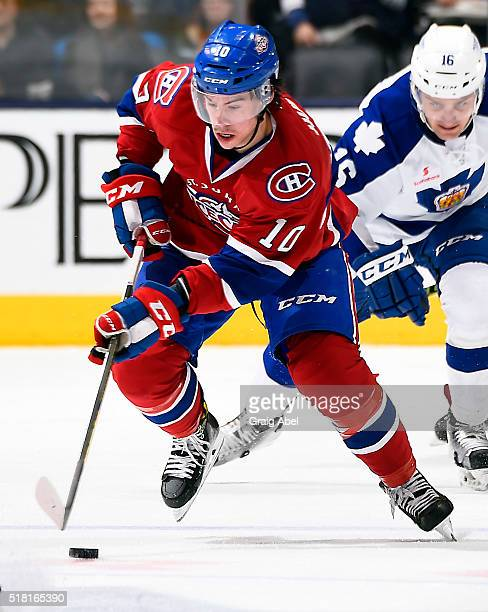 Charles Hudon of the St John's IceCaps carries the puck up ice against the Toronto Marlies during game action on March 26 2016 at Air Canada Centre...