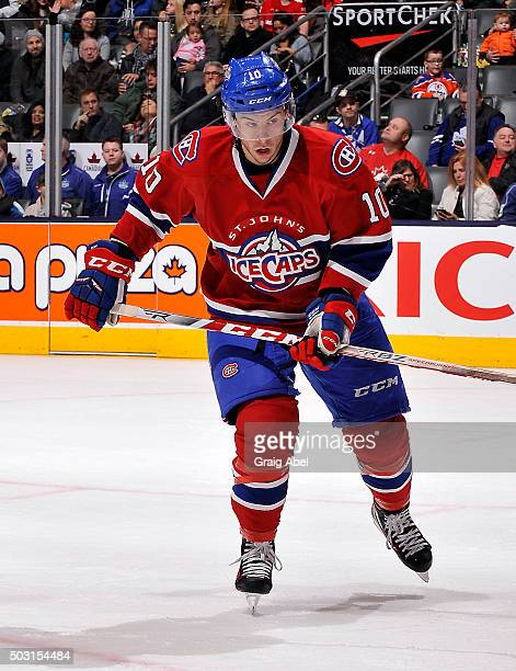 Charles Hudon of the St Johns IceCaps skates up ice against the Toronto Marlies during AHL game action on December 26 2015 at Air Canada Centre in...