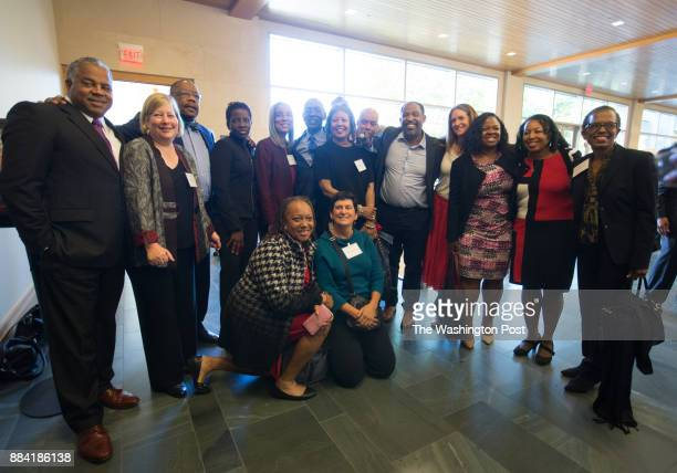 Charles J Ogletree poses with a group with the District of Columbia Public Defender Service following a celebratory symposium honoring the Harvard...