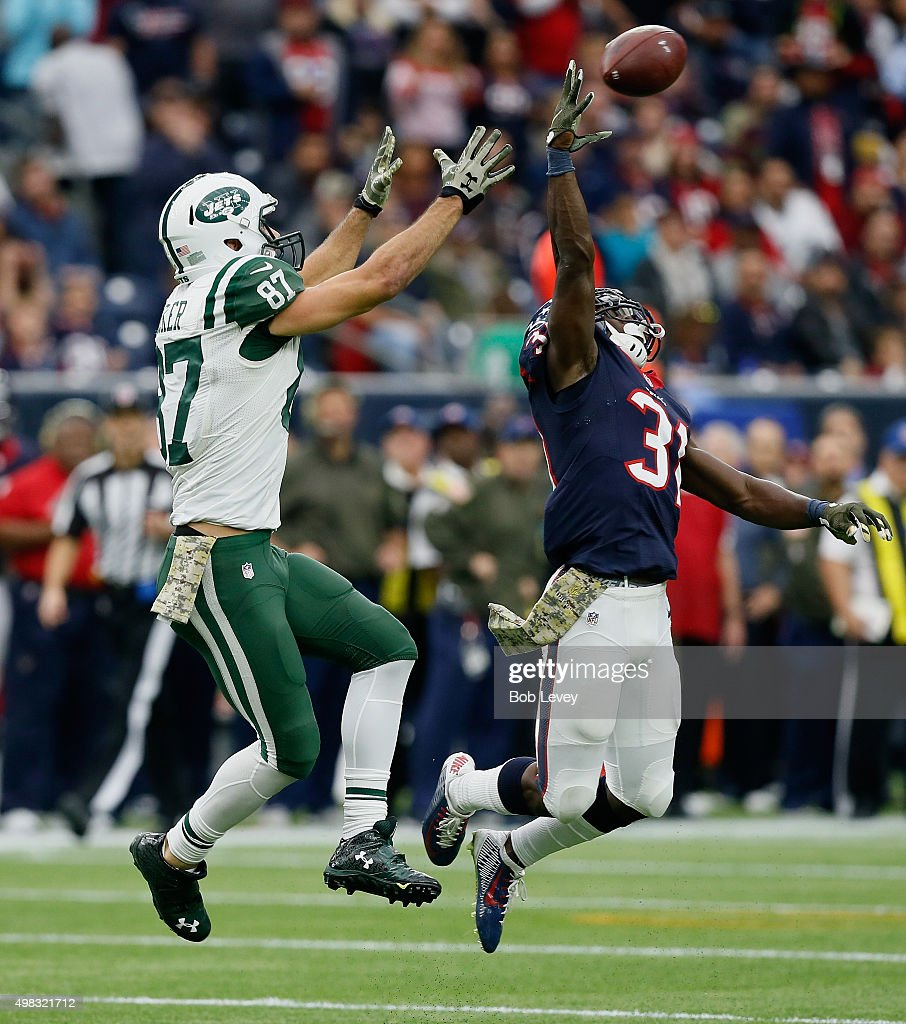 Charles James #31 of the Houston Texans tips the ball away from Eric Decker #87 of the New York Jets at NRG Stadium on November 22, 2015 in Houston, Texas.