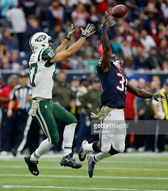 Charles James of the Houston Texans tips the ball away from Eric Decker of the New York Jets at NRG Stadium on November 22 2015 in Houston Texas