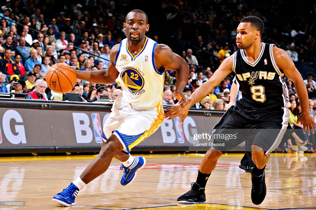 Charles Jenkins #22 of the Golden State Warriors drives against Patrick Mills #8 of the San Antonio Spurs on April 26, 2012 at Oracle Arena in Oakland, California.