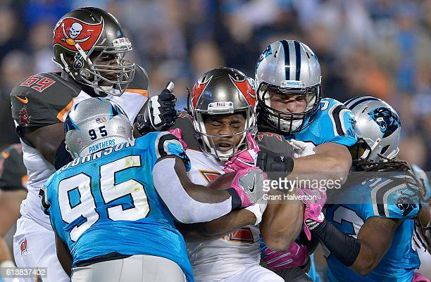 Charles Johnson and teammate Luke Kuechly of the Carolina Panthers tackle Jacquizz Rodgers of the Tampa Bay Buccaneers in the 1st quarter during the...