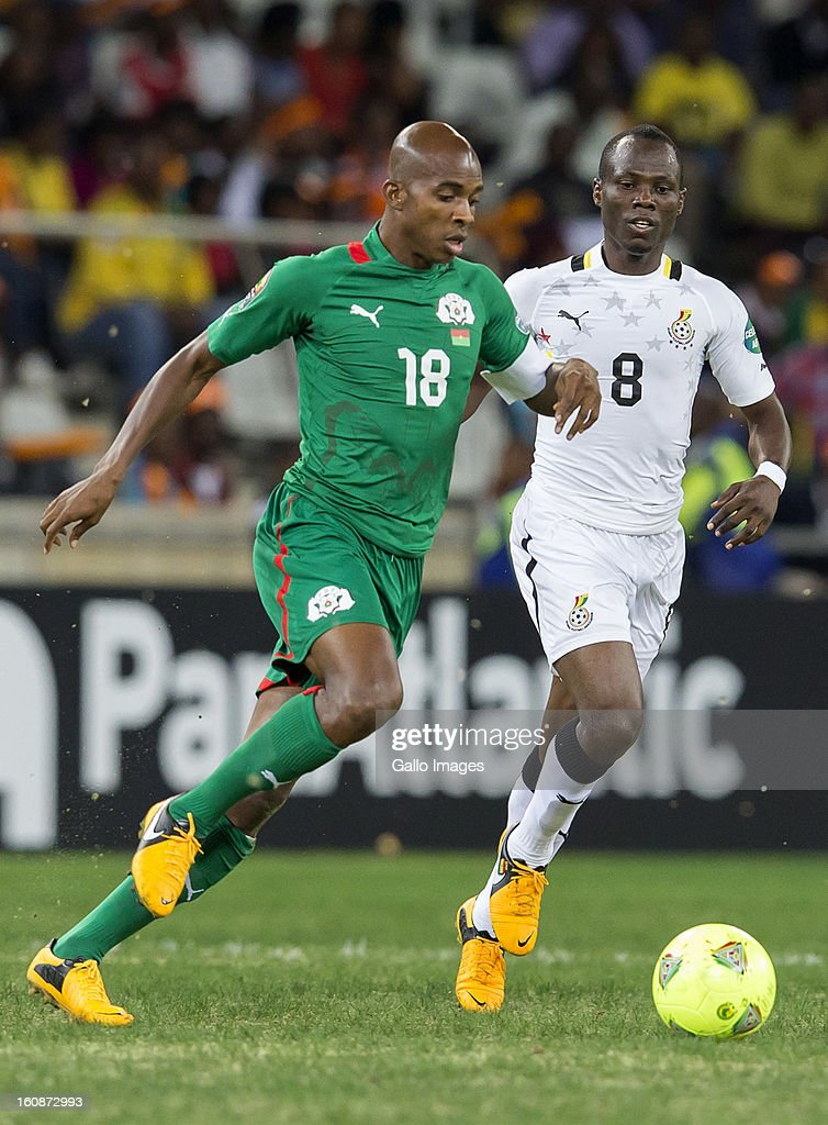 AFRICA - FEBRUARY 06, Charles Kabore (Captain) from Burkina Faso (L) and Emmanuel Agyeman Badu from Ghana during the 2013 Orange African Cup of Nations 2nd Semi Final match between Burkina Faso and Ghana at Mbombela Stadium on February 06, 2013 in Nelspruit, South Africa.