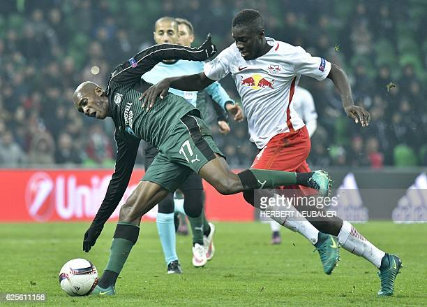Charles Kabore of FC Krasnodar and Dayot Upamecano of FC Salzburg vie for the ball during the UEFA Europa League group I football match between FC...