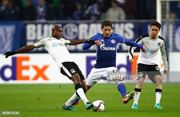 Charles Kabore of FC Krasnodar is closed down by Benjamin Stambouli of FC Schalke 04 during the UEFA Europa League Group I match between FC Schalke...