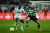 Charles Kabore of Marseille challenges Thorben Marx of Moenchengladbach during the UEFA Europa League group C match between Borussia Moenchengladbach...