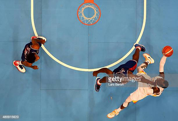 Charles Kahudi of France challenges Dennis Schroeder of Germany during the Men's Basketball friendly match between Germany and France at Lanxess...