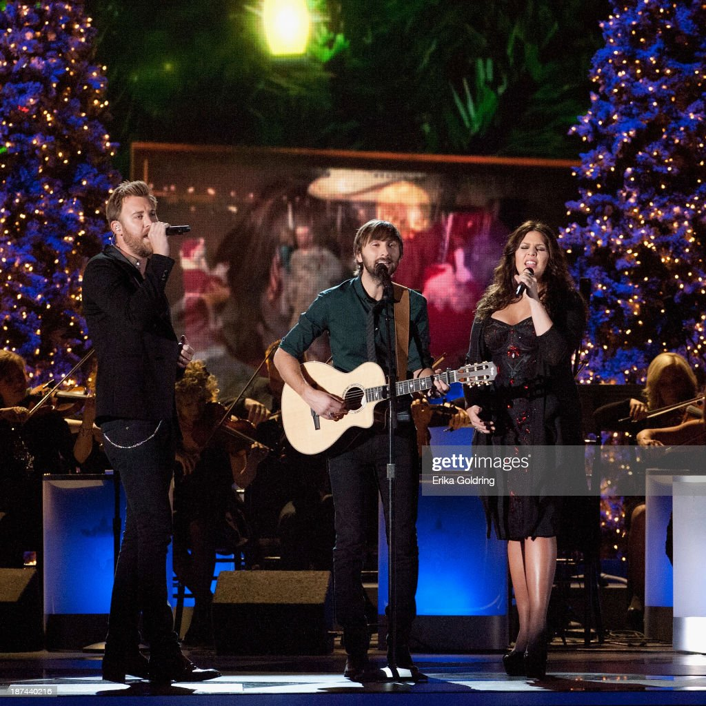 <a gi-track='captionPersonalityLinkClicked' href=/galleries/search?phrase=Charles+Kelley&family=editorial&specificpeople=3935435 ng-click='$event.stopPropagation()'>Charles Kelley</a>, <a gi-track='captionPersonalityLinkClicked' href=/galleries/search?phrase=Dave+Haywood&family=editorial&specificpeople=4620526 ng-click='$event.stopPropagation()'>Dave Haywood</a> and Hillary Scott of Lady Antebellum perform during the CMA 2013 Country Christmas on November 8, 2013 in Nashville, Tennessee.