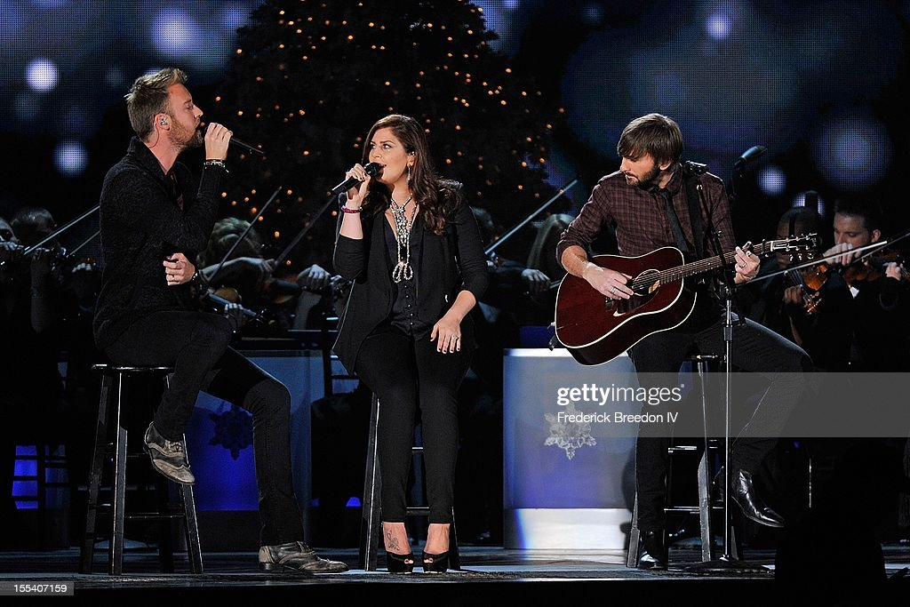 <a gi-track='captionPersonalityLinkClicked' href=/galleries/search?phrase=Charles+Kelley&family=editorial&specificpeople=3935435 ng-click='$event.stopPropagation()'>Charles Kelley</a>, Hillary Scott, and <a gi-track='captionPersonalityLinkClicked' href=/galleries/search?phrase=Dave+Haywood&family=editorial&specificpeople=4620526 ng-click='$event.stopPropagation()'>Dave Haywood</a> of Lady Antebellum perform during the 2012 Country Christmas at the Bridgestone Arena on November 3, 2012 in Nashville, United States.