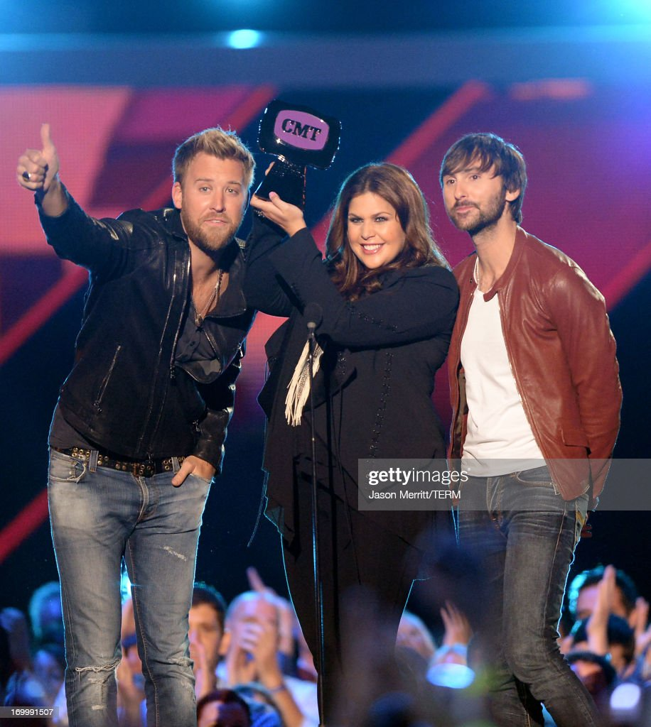 <a gi-track='captionPersonalityLinkClicked' href=/galleries/search?phrase=Charles+Kelley&family=editorial&specificpeople=3935435 ng-click='$event.stopPropagation()'>Charles Kelley</a>, Hillary Scott and <a gi-track='captionPersonalityLinkClicked' href=/galleries/search?phrase=Dave+Haywood&family=editorial&specificpeople=4620526 ng-click='$event.stopPropagation()'>Dave Haywood</a> of Lady Antebellum accept award onstage during the 2013 CMT Music awards at the Bridgestone Arena on June 5, 2013 in Nashville, Tennessee.