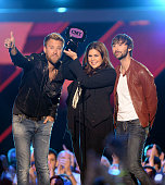 Charles Kelley Hillary Scott and Dave Haywood of Lady Antebellum accept award onstage during the 2013 CMT Music awards at the Bridgestone Arena on...