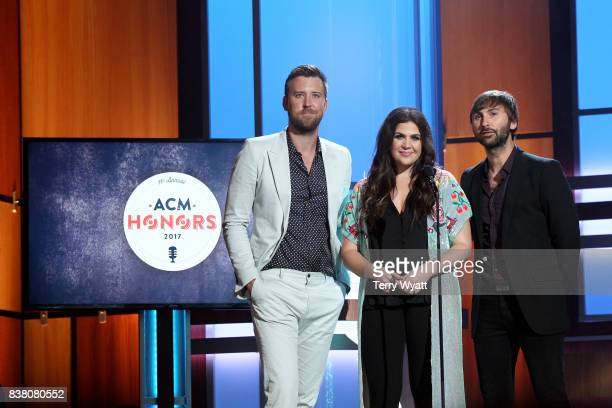 Charles Kelley Hillary Scott and Dave Haywood of Lady Antebellum speak onstage during the 11th Annual ACM Honors at the Ryman Auditorium on August 23...