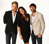Charles Kelley Hillary Scott and Dave Haywood of Lady Antebellum pose in the Wonderwallcomcom Portrait Studio during 2012 CMT Music awards at the...