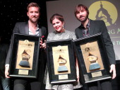 Charles Kelley Hillary Scott and Dave Haywood of Lady Antebellum pose for a photo after receiving the Recording Artists' Coalition Award at the...