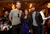 Charles Kelley Hillary Scott and Dave Haywood of Lady Antebellum pose backstage at the Cumulus/Westwood One Radio Remotes during the 49th Annual...