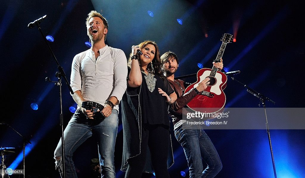 <a gi-track='captionPersonalityLinkClicked' href=/galleries/search?phrase=Charles+Kelley&family=editorial&specificpeople=3935435 ng-click='$event.stopPropagation()'>Charles Kelley</a>, Hillary Scott, and <a gi-track='captionPersonalityLinkClicked' href=/galleries/search?phrase=Dave+Haywood&family=editorial&specificpeople=4620526 ng-click='$event.stopPropagation()'>Dave Haywood</a> of the band Lady Antebellum perform at LP Field during the 2013 CMA Music Festival on June 7, 2013 in Nashville, Tennessee.