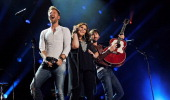 Charles Kelley Hillary Scott and Dave Haywood of the band Lady Antebellum perform at LP Field during the 2013 CMA Music Festival on June 7 2013 in...
