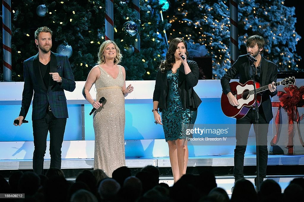 <a gi-track='captionPersonalityLinkClicked' href=/galleries/search?phrase=Charles+Kelley&family=editorial&specificpeople=3935435 ng-click='$event.stopPropagation()'>Charles Kelley</a>, <a gi-track='captionPersonalityLinkClicked' href=/galleries/search?phrase=Jennifer+Nettles&family=editorial&specificpeople=619734 ng-click='$event.stopPropagation()'>Jennifer Nettles</a>, Hillary Scott, and <a gi-track='captionPersonalityLinkClicked' href=/galleries/search?phrase=Dave+Haywood&family=editorial&specificpeople=4620526 ng-click='$event.stopPropagation()'>Dave Haywood</a> perform during the 2012 Country Christmas at the Bridgestone Arena on November 3, 2012 in Nashville, United States.