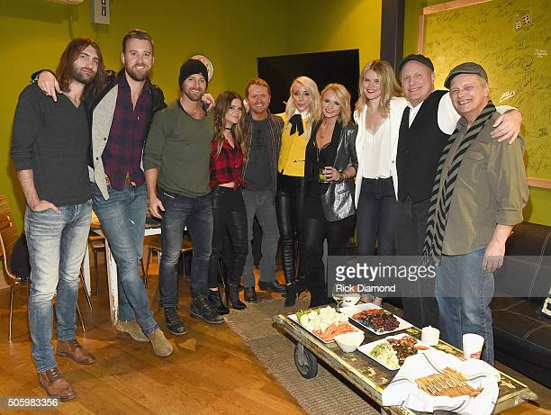Charles Kelley Kip Moore Maren Morris Shane McAnally Ashley Monroe Miranda Lambert Nicolle Galyon Collin Raye and Scotty Wray pose backstage during...