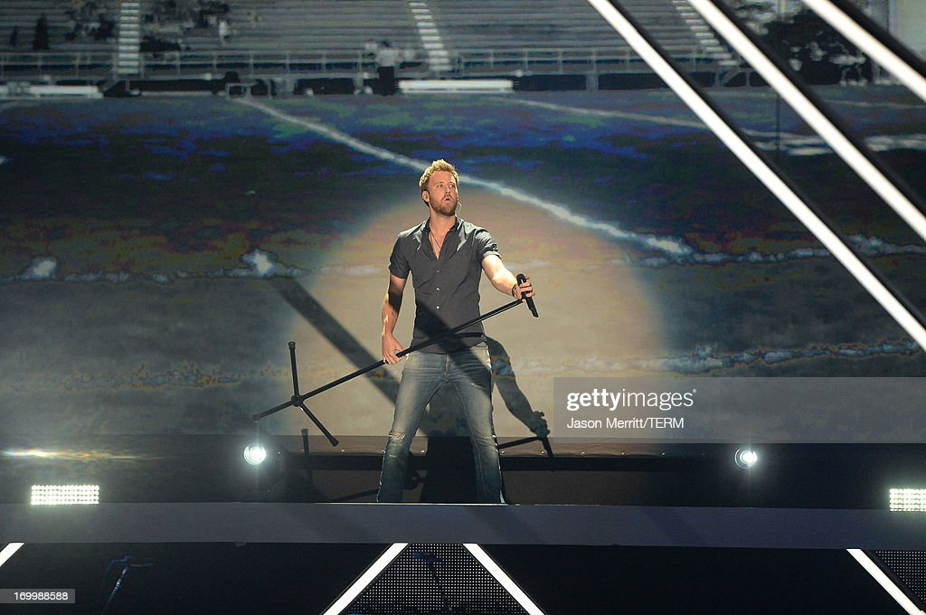 <a gi-track='captionPersonalityLinkClicked' href=/galleries/search?phrase=Charles+Kelley&family=editorial&specificpeople=3935435 ng-click='$event.stopPropagation()'>Charles Kelley</a> of Lady Antebellum performs onstage during the 2013 CMT Music awards at the Bridgestone Arena on June 5, 2013 in Nashville, Tennessee.