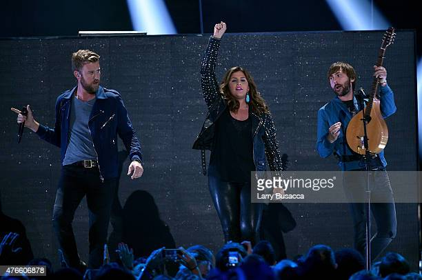 Charles Kelly Hillary Scott and Dave Haywood of Lady Antebellum perform onstage during the 2015 CMT Music awards at the Bridgestone Arena on June 10...