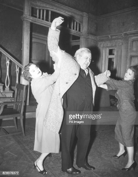 Charles Laughton proves more than a handful for Elsa Elsa Lanchester and Joyce Redman in this scene from 'The Party' in rehearsal at the New Theatre...