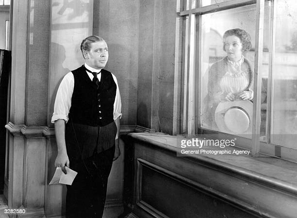 Charles Laughton spies ZaSu Pitts the American actress and comedienne through the window in a scene from 'Ruggles Of Red Gap' about a British butler...