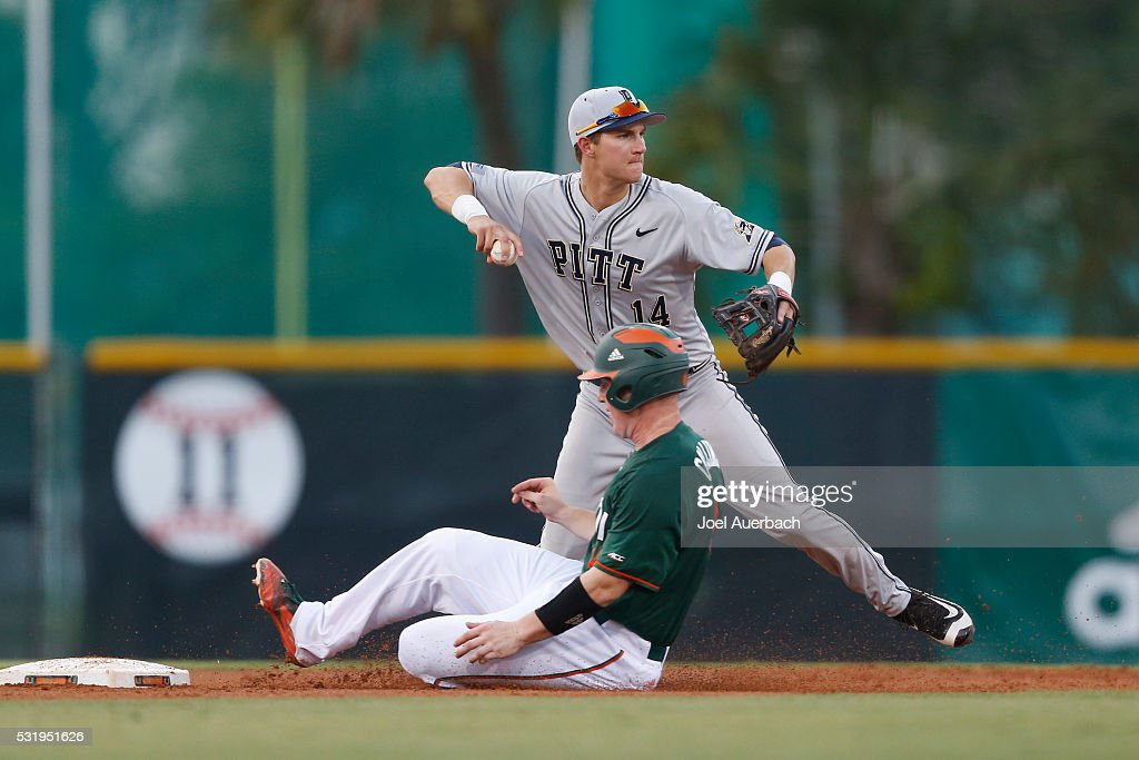 Charles Leblanc of the Pittsburgh Panthers turns the double play getting Zack Collins of the Miami Hurricanes out at second base during first inning...