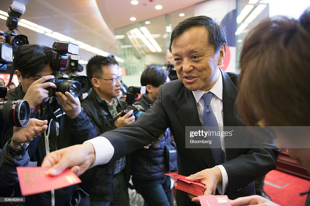 Charles Li, chief executive officer of Hong Kong Exchanges & Clearing Ltd. (HKEx), hands out red envelopes of money, known as 'lai-see', to members of the media on the first day of trading after lunar new year at the bourse in Hong Kong, China, on Thursday, Feb. 11, 2016. Hong Kong stocks headed for their worst start to a lunar new year since 1994 as a global equity rout deepened amid concern over the strength of the world economy. Photographer: Xaume Olleros/Bloomberg via Getty Images