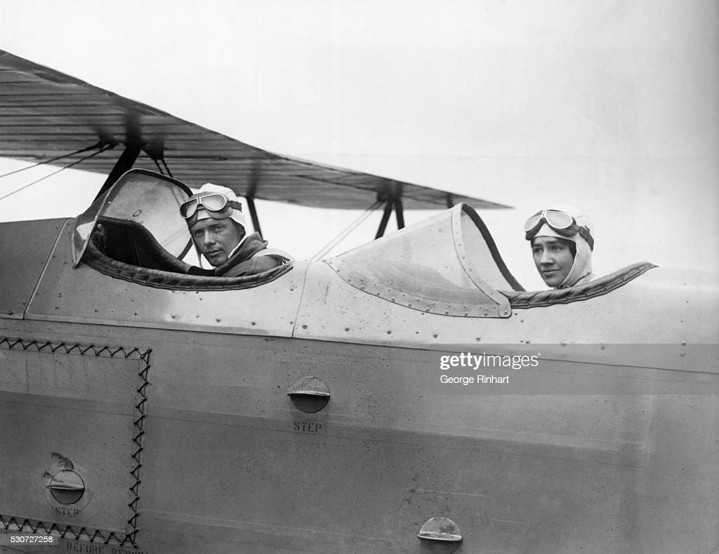 <a gi-track='captionPersonalityLinkClicked' href=/galleries/search?phrase=Charles+Lindbergh&family=editorial&specificpeople=70029 ng-click='$event.stopPropagation()'>Charles Lindbergh</a> and Bride in Cockpit of airplane.