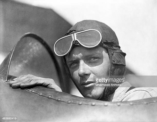Charles Lindbergh wearing helmet with goggles up in an open cockpit of an airplane at Lambert Field St Louis Missouri 1923