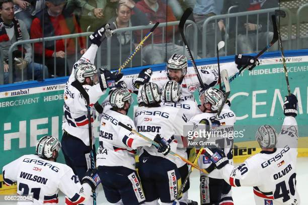 Charles Linglet of Berlin celebrates scoring the decisive goal during the DEL Playoffs quarter finals Game 7 between Adler Mannheim and Eisbareren...
