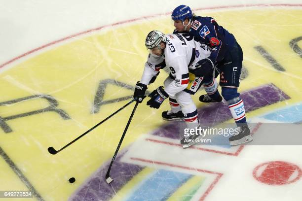 Charles Linglet of Berlin is challenged by David Wolf of Mannheim during the DEL Playoffs quarter finals Game 1 between Adler Mannheim and Eisbareren...