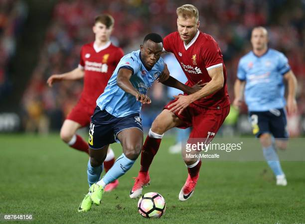 Charles Lokoli Ngoy of Sydney FC takes on Ragnar Klavan of Liverpool during the International Friendly match between Sydney FC and Liverpool FC at...